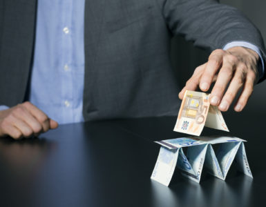 A man builds pyramids from money.
